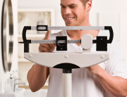 Man weighing himself on a scale